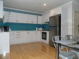 Fully equipped kitchen with full size fridge microwave and washing machine