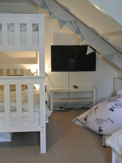 Kids room: bunk bed and wall mounted 40 inch LCD for films and games. Also has a single  and truckle