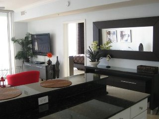 Enjoy ocean front family room with large screen TV