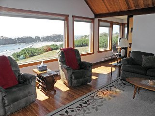 The living room, kitchen, and den all face due west and have great views.