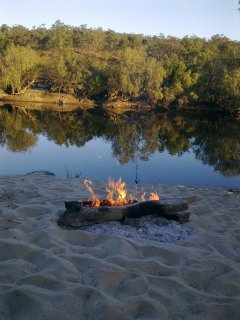 Campfire in The Bush by a Waterhole