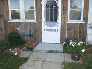 The entrance is inviting and includes a motion light and electronic locks on the door.