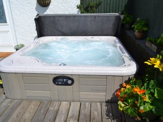 Enjoy the outdoor hot tub experience