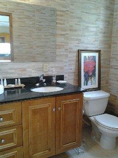 Separate Guest house marble & Tile bath...