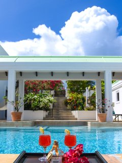 Have a rum punch pool side and enjoy the tropical view
