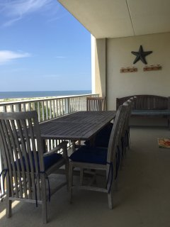 Large dining table for alfresco dining. What a view!