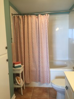 Stay relaxed with our large soaking tub and shower.