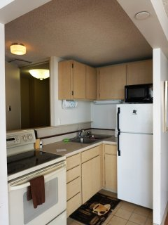 Kitchen offers a full stove and oven, refrigerator, rice cooker, toaster, coffee pot, and more!