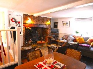 Living room with huge inglenook fireplace