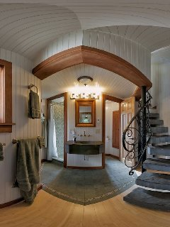 Tower Cottage Bathroom, Glass Tiled Shower on the Left, Stone Sink in Center, Toilet on Left