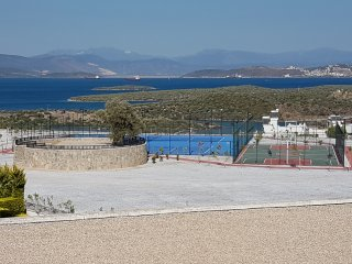 The view from the balcony across the tennis and basketball courts to the bay of Gulluk