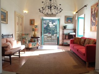 Living room with French doors opening to the terrace