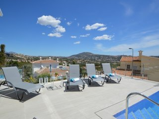 Large terrace with sunbeds and outdoor shower and magnificent open views.