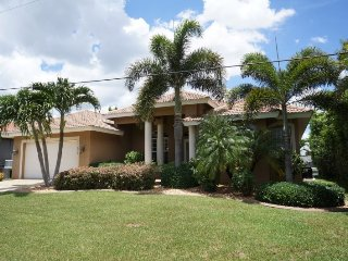 Alicia 1014 - SE Cape Coral Luxury Electric Heated Pool/Spa Home, walking distance to Cape Coral Beach, Marina and Entertainment, Modern Contemporary Furnished, Foosball Table and much more......