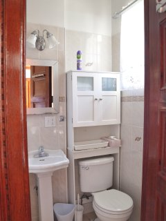 Analita's Bathroom with Toilet, Sink and Bath and Shower combination