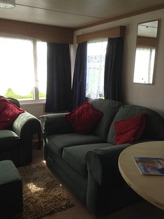 Two 2 seater settees in living room