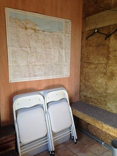 Utility room with map of the area and seating platform