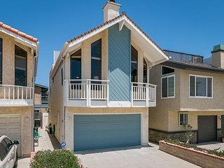 Beachside Beauty in Oxnard with Multiple Living Areas and Deck