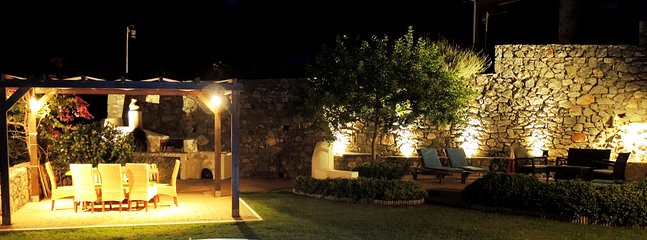 The pergola and the deck area at night.