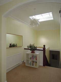 Upper landing hallway with skylight (inside the apartment)