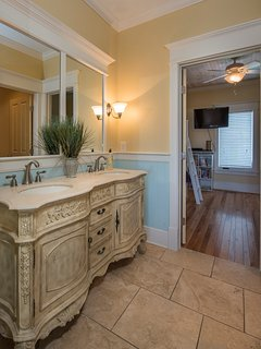 Jack-and-Jill bathroom is shared by queen and bunk bedrooms.