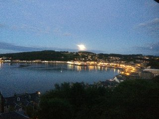 Sun going down over Rothesay from window