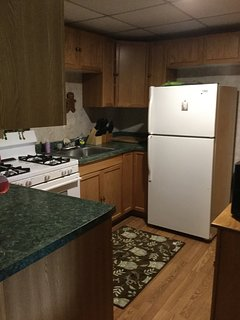 The unit includes a full kitchen.