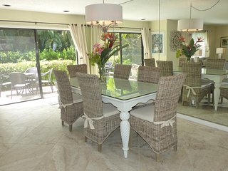 Dining area comfortably seats six and overlooks outdoor deck.