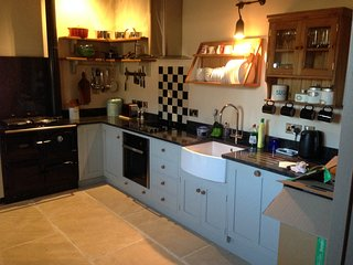 Well equipped kitchen with Rayburn cooker and electric cooker