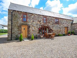 THE HAYLOFT, semi-detached, stone-built barn conversion, pet-friendly, WiFi, par