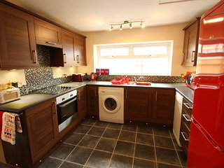 Fully equipped brand new kitchen with complimentary coffee, tea, sugar and fresh milk.