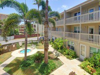 Dog-friendly condo near the beach with shared pool and hot tub!