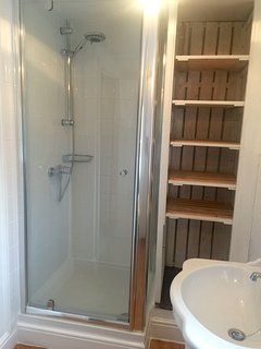 Lovely white tiled quality shower room.