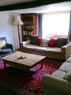 Lounge with main window overlooking back garden.
