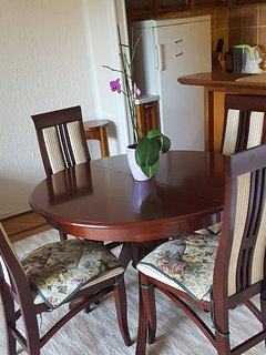Dining table can be used for 4 chairs or extended for 6 chairs