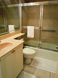 Guest bathroom tub/shower , Hair dryer. All linens are supplied.