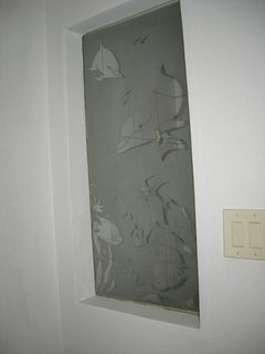 Custom etched window in the hall stall shower