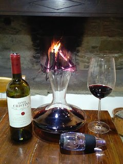 A nice Tuscan Red by the fire in the kitchen in winter
