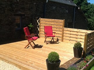The rear decking with BBQ and sun loungers