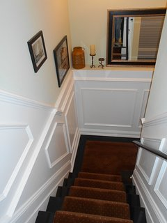 Stairs to lower level , to Childrens room and family room and 2 swans suite