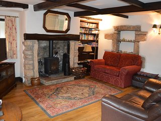 Lounge with woodburner and 40' TV
