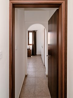 Leading into main bedroom