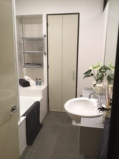 Beautiful bathroom with bath & storage in CBD Little Paris in the heart of Melbourne's shopping area