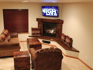 LIVING AREA W/ LARGE FLAT SCREEN TV