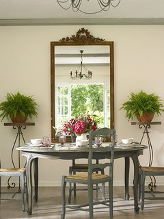 The dining area with large antique French mirror to reflect the views