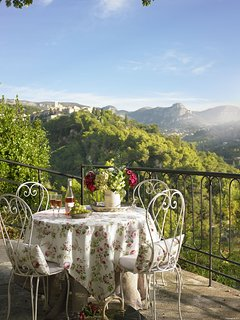Stunning village and mountain views can be enjoyed from the upper terrace