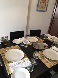 Table in dining area of great room seats 6. Use placemats or tablecloths.