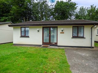 TREBELLAN, pet-friendly chalet on wooded holiday park with off road parking, in