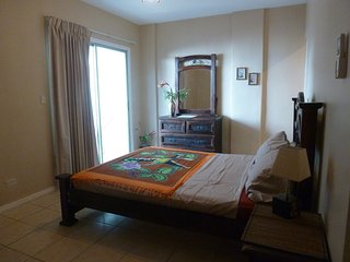 Master Bedroom with WalkOut to Balcony