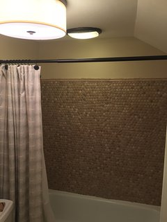 Upstairs Master bath with textured woven tumbled marble